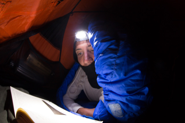 Reading in the tent by headlight