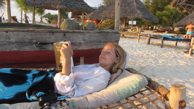 Meike reading on the beach