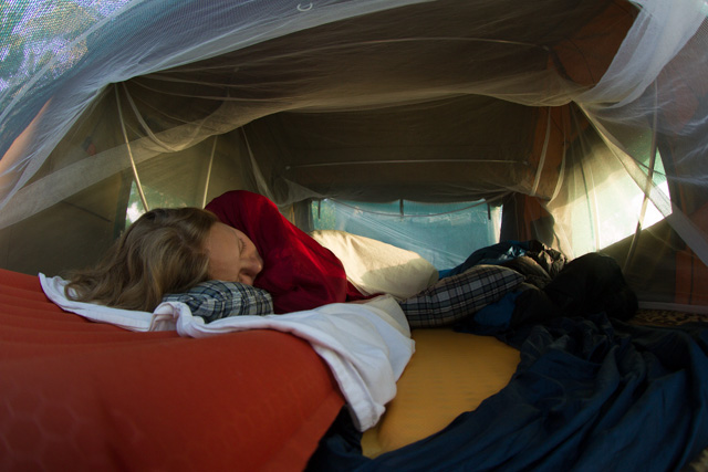 In a tent on a 4x4 at the beach