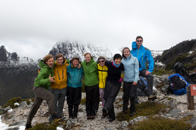 The expedition group stnading against all elements