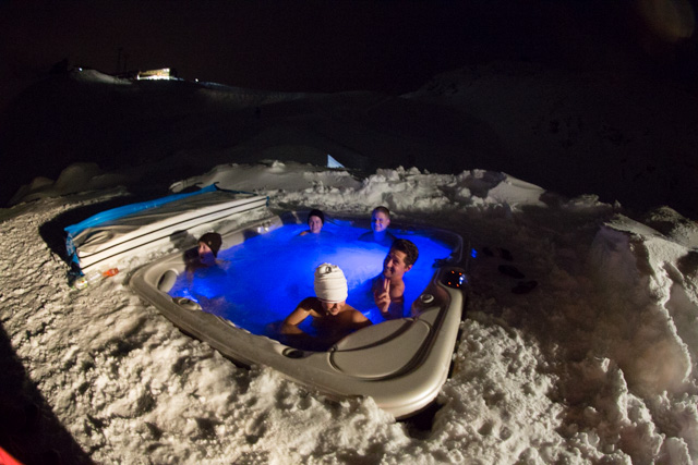 Sitting in the outdoor hot tub watching the slopes being prepared