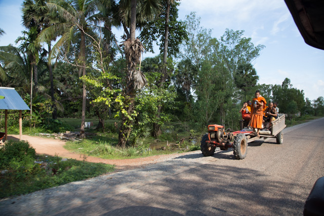 Monks on 2-wheel tractor