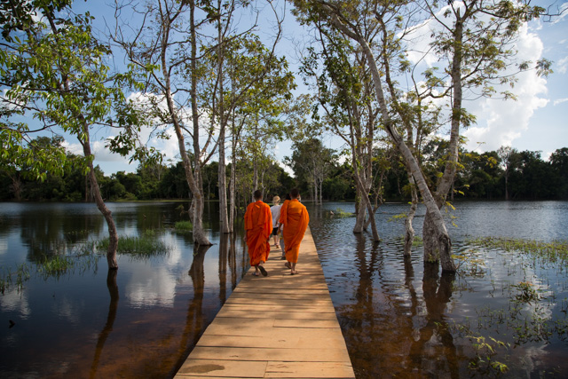 Monks crossing bridge