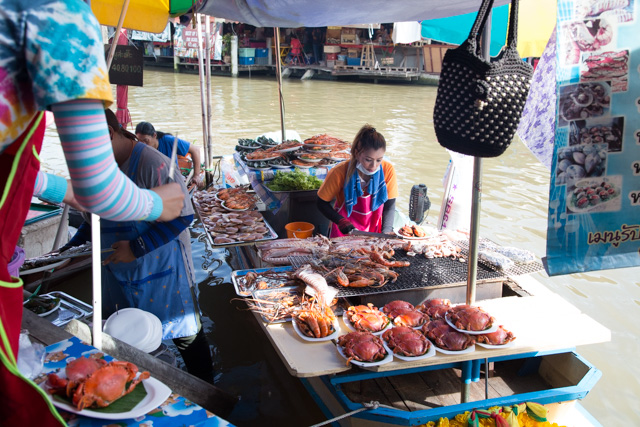 Someone cooking seafood on a river boat